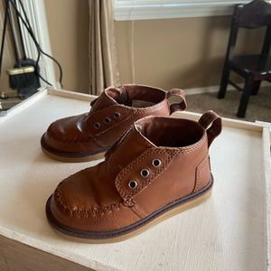Toddler TOMS brown leather booties.